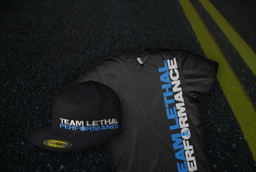 Black hat and t-shirt with Lethal Performance text against a double yellow line